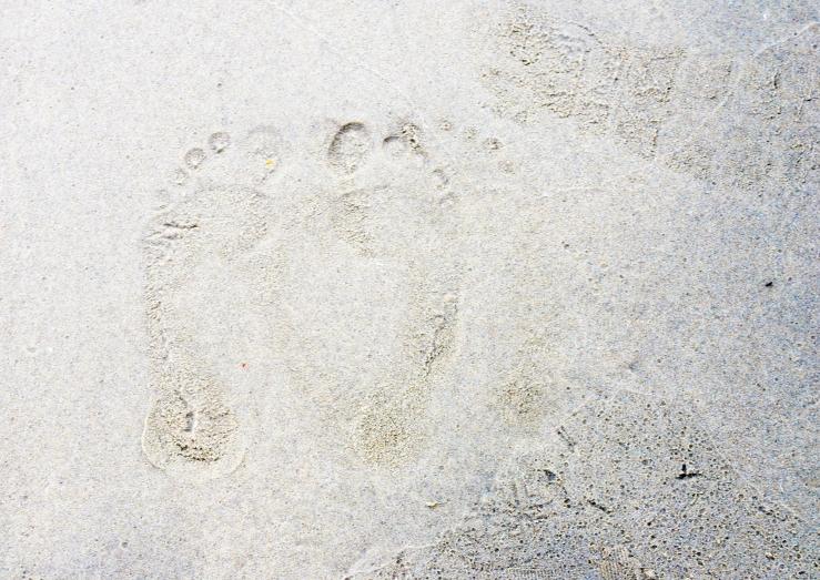 Footprints in the sand at Lyme Regis, Dorset.