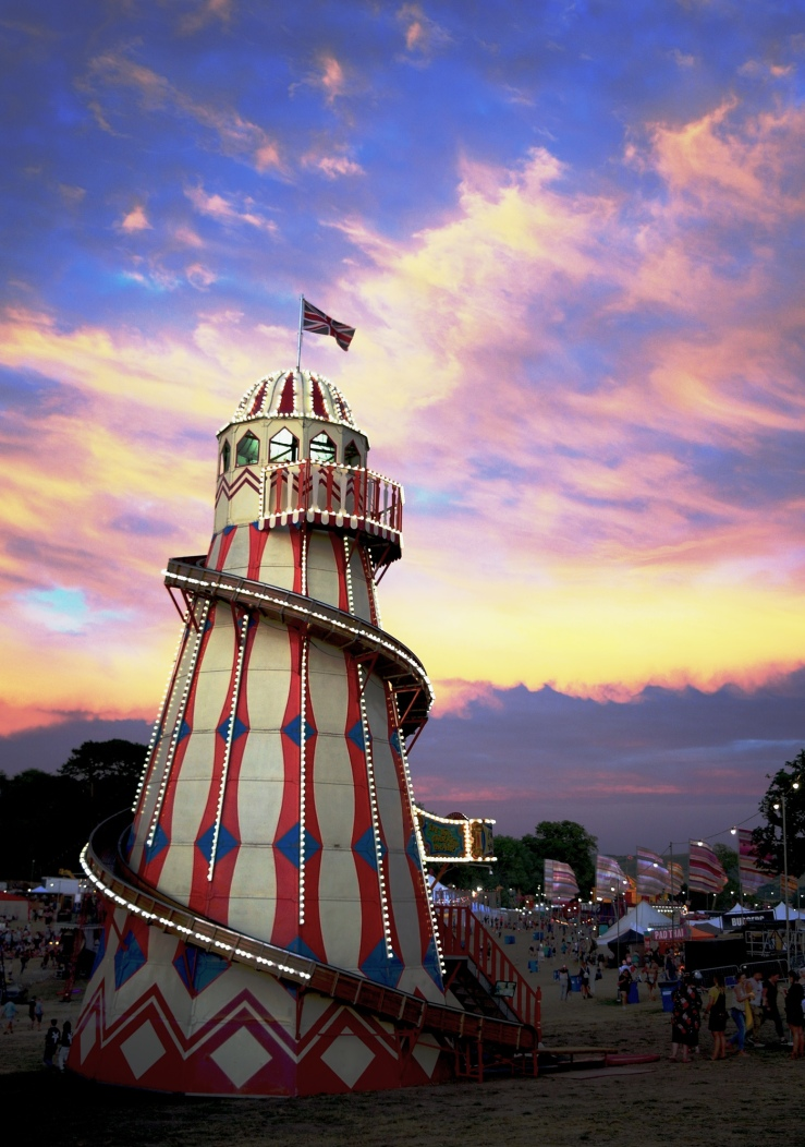 Sunset sky and helter skelter at Bestival 2018, Lulworth Estate, Dorset. Bestival circus 2018. Vintage funfair ride.